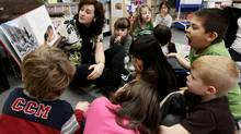 Teacher Jaime Fernie reads an Aboriginal-themed book to her all-day kindergarten and grade 1 class at Mission Central Elementary School in Mission, B.C., on Thursday December 16, 2010. (Darryl Dyck For The Globe and Mail/Darryl Dyck For The Globe and Mail)