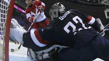 Team USA's goalie Jonathan Quick stretches to make a save on Russia's Ilya Kovalchuk (L) during a shootout in their men's preliminary round ice hockey game at the Sochi 2014 Winter Olympic Games February 15, 2014. (POOL/REUTERS)