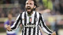 Juventus' Andrea Pirlo celebrates after scoring during an Europa League, round of 16, return-leg soccer match between Fiorentina and Juventus at the Artemio Franchi stadium in Florence, Italy, Thursday, March 20, 2014. (Daniele Badolato/AP)