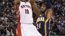 Toronto Raptors' DeMar DeRozan (left) shoots on Indiana Pacers' Paul George during first half NBA basketball action in Toronto on Wednesday January 1 , 2014. (CHRIS YOUNG/THE CANADIAN PRESS)
