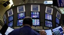 In this Thursday, March 15, 2012, file photo, traders work at the Goldman Sachs posts on the floor of the New York Stock Exchange. (Richard Drew/AP Photo)