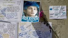 Messages posted to a pillar at Rogers Arena in Vancouver honour the memory of former Vancouver Canuck Rick Rypien in August 2011. (Darryl Dyck/The Canadian Press)