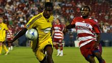 Columbus Crew's Andy Iro, left, controls the ball as FC Dallas' Jeff Cunningham, right moves in during a MLS soccer game in Frisco, Texas on Saturday, Aug. 30, 2008. (Mark M. Hancock/THE CANADIAN PRESS)