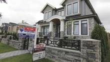 Realtors' signs are hung outside a newly sold property in a Vancouver neighbourhood on Sept. 9, 2014. (Julie Gordon/Reuters)