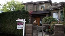 Realtor Julia Hsu preparesforan open house at a home listedfor sale for$4.99-million in the neighbourhood of Shaughnessy, in Vancouver, B.C., on Saturday April 25, 2015. (DARRYL DYCK For The Globe and Mail)