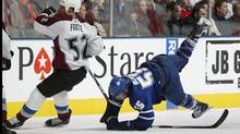 Colorado Avalanche captain Adam Foote gets tangled up with Jason Blake of the Toronto Maple Leafs in an Oct. 13 NHL game. (Claus Andersen/2009 Getty Images)