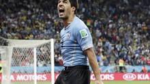 Uruguay's Luis Suarez as he celebrates after scoring (Matt Dunham/AP)