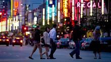 Pedestrians walk along Granville Street in Vancouver last June. (File photo) (John Lehmann/The Globe and Mail)