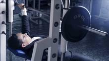 Businessman lifting weights. (Photos.com)