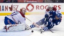 Toronto Maple Leafs centre Mikhail Grabovski (84) is hauled down by Montreal Canadiens defenceman Alexei Emelin (74) as he tries to shoot on goaltender Carey Price during second period NHL action in Toronto on Wednesday February 27, 2013. If the season ended now, there would be five Canadian-based teams in the post-season, including Montreal, Winnipeg, Ottawa and Toronto in the Eastern Conference and Vancouver in the west. (Frank Gunn/THE CANADIAN PRESS)
