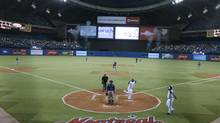 Jose Bautista crosses the plate following his home run during fourth inning (Christinne Muschi/Christinne Muschi/The Globe and)
