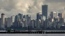 The downtown skyline of Vancouver, British Columbia is shown across English Bay February 8, 2010. (Andy Clark/ Reuters/Andy Clark/ Reuters)