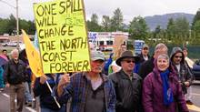 Protestors march through the streets of Kitimat, B.C., on June 24, 2012, in a rally against the Northern Gateway pipeline project. (Robin Rowland/THE CANADIAN PRESS)