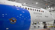 Bombardier's CS300 Aircraft, showing its Pratt & Whitney engine in the foreground, sits in the hangar prior to its test flight in Mirabel, Que., in this February 27, 2015, file photo. (CHRISTINNE MUSCHI/REUTERS)