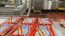 Packages of Maple Leaf Foods wieners are seen in this file photo. (Peter Power/Peter Power/The Globe and Mail)