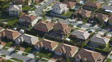 Growth, Horizontal, Outdoors, House, Aerial View, Suburb, Street, Day, Florida - USA, Color Image, Housing Development, Community, Series, No People, Photography (George Doyle/Getty Images/Stockbyte Platinum)