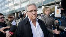 Antonio Accurso leaves the SQ headquarters in Montreal, Tuesday, April 17, 2012, after being arrested on charges relating to corruption. (Graham Hughes/THE CANADIAN PRESS)