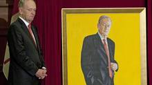 Former prime minister Jean Chretien stands next to his official portrait at the unveiling ceremony on Parliament Hill in Ottawa on May 25, 2010. (Adrian Wyld/THE CANADIAN PRESS)