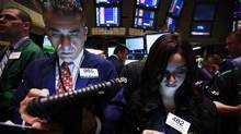 Traders work on the floor of the New York Stock Exchange May 7, 2012. (BRENDAN MCDERMID/REUTERS/Brendan McDermid)