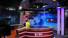This picture taken on June 12, 2012 shows China Central Television (CCTV) Africa's news presenter Beatrice Marshall in the studio of the premises of the television in Nairobi. (SIMON MAINA/AFP/Getty Images/Newscom)