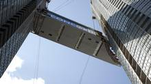 SkyBridge reaches its docking point between two Parade towers in downtown Toronto. (Concord Adex)