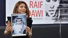 Ensaf Haidar holds a picture of her husband, Raif Badawi, after accepting a human rights prize on behalf of her husband, at the European Parliament in Strasbourg, France, on Dec. 16, 2015. (PATRICK HERTZOG/AFP/Getty Images)