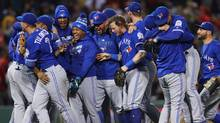 The Toronto Blue Jays celebrate clinching a Wildcard spot in the playoffs after their 2-1 win over the Boston Red Sox at Fenway Park on October 2, 2016 in Boston, Massachusetts. (Maddie Meyer/Getty Images)