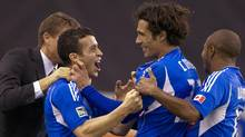 Montreal Impact's Bernardo Corradi (2nd R) celebrates his goal with team mates Felipe Martins (2nd L), Collen Warner (R) and coach Jesse Marsch (L) during the second half of their MLS soccer match against Portland Timbers in Montreal, Quebec, April 28, 2012. REUTERS/Christinne Muschi (Christinne Muschi/Reuters)