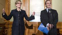 Ontario Premier Kathleen Wynne, left, speaks with Deputy Mayor of Toronto Norm Kelly after their meeting in Toronto, Tuesday Dec. 3, 2013. This marks the first time a meeting between the city and province since Toronto city council stripped Toronto Mayor Rob Ford of some of his powers. (Mark Blinch/THE CANADIAN PRESS)