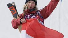 Canada's Dara Howell celebrates after taking the gold medal in the women's freestyle skiing slopestyle final at the Rosa Khutor Extreme Park at the 2014 Winter Olympics on Feb. 11 in Krasnaya Polyana, Russia. (Andy Wong/AP)