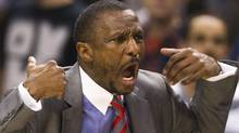 Toronto Raptors head coach Dwane Casey gestures to official Scott Foster after Foster called a five second violation when the Raptors failed to inbound the ball in the final seconds of the game as the Los Angeles Lakers defeated the Raptors in Toronto on Sunday, Feb. 12, 2012. THE CANADIAN PRESS/Nathan Denette (Nathan Denette/CP)