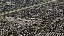 A suburban area is seen from the air in Calgary, Alta., Thursday, July 11, 2013. (Jeff McIntosh/THE CANADIAN PRESS)