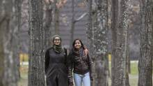 Students Aniqah Iqram, left, and Barrah Faysal are doing research together with youth leaders in Scarborough. (J.P. MOCZULSKI for the globe and mail)