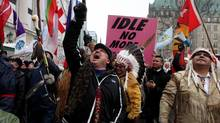 First nations chiefs and supporters march toward Parliament Hill during an Idle No More protest on Jan. 11, 2013. First nations leaders have urged protesters to remain peaceful in upcoming demonstrations. (Dave Chan For The Globe and Mail)
