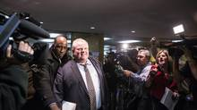 Toronto Mayor Rob Ford walks past reporters as he leaves his office at City Hall: The storm continues. (Chris Young For The Globe and Mail)