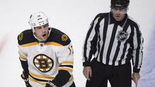 Boston Bruins' Milan Lucic is escorted off the ice (Paul Chiasson/THE CANADIAN PRESS)