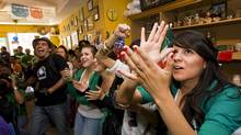 Soccer fans gather to watch Mexico take on South Africa in the opening game of the 2010 World Cup at Mexican restaurant El Jacal in Toronto on Friday, June 11, 2010. (Adrien Veczan/THE CANADIAN PRESS)