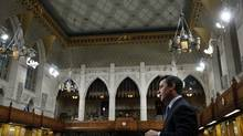 Conservative Member of Parliament Michael Chong tables his private member's bill aimed at giving MPs more power, in the House of Commons on Dec. 3, 2013. (CHRIS WATTIE/REUTERS)