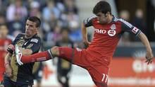 Toronto FC's Nathan Sturgis, right, collides with Philadelphia Union's Sebastien Le Toux during the second half of an MLS soccer match, Saturday, Oct. 15, 2011, in Chester, Pa. (Michael Perez/Associated Press)