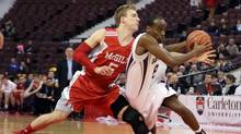 McGill University Redman Simon Bibeau (5) attempts to block Ottawa University Gee Gees Johnny Berhanemeskel (8) during Canadian Interuniversity Sport basketball action in Ottawa on Friday, March 8, 2013. (FRED CHARTRAND/THE CANADIAN PRESS)