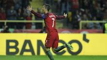 Portugal's Cristiano Ronaldo celebrates after scoring his team second goal against Andorra during their World Cup Group B qualifying match at the Municipal Stadium in Aveiro, Portugal on Friday Oct. 7, 2016. (Paulo Duarte/AP)