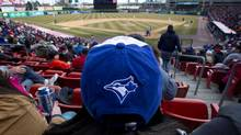 The Buffalo Bisons, the Toronto Blue Jays minor league team this year, played their home opener against the Rochester Red Wings on a sunny, but cool afternoon at Coca-Cola field in Buffalo on April 4, 2013. (Peter Power/The Globe and Mail)