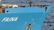 In this Oct. 19, 2008, file photo released by the United States Navy, Somali pirates holding the merchant vessel MV Faina stand on the deck of the ship. (AP/U.S. Navy, Petty Officer 2nd Class Jason R. Zalasky/AP/U.S. Navy, Petty Officer 2nd Class Jason R. Zalasky)