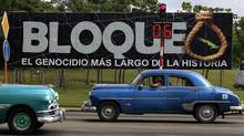 A Havana billboard: 'Blockade, history's longest genocide.' (ENRIQUE DE LA OSA/REUTERS)