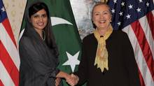 U.S. Secretary of State Hillary Clinton, right, meets with Pakistan's Foreign Minister Hina Rabbani Khar in New York on Sept. 18, 2011. (Stan Honda/AFP/Getty Images)