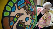 Maggie Hatfield, a 64-year-old retired teacher, shows the painting she believed was a 1979 canvas by Norval Morrisseau in her Sarnia, Ont., home on May 31, 2012. (Brent Foster/Brent Foster for The Globe and Mail)
