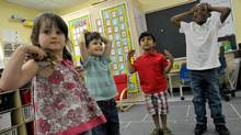 (L-R) Millie Bolton, Alfie Bolton, Prathmesh Mistry and Mekhi Rutherford play games in their classroom, June 4, 2011. (J.P. Moczulski/Special to the Globe and Mail)