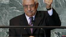 Palestinian President Mahmoud Abbas holds up a copy of the letter that he had just delivered to United Nations Secretary General Ban Ki-moon requesting full United Nations representation for a Palestinian state, during his address before the 66th United Nations General Assembly at U.N. headquarters in New York, September 23, 2011. (MIKE SEGAR/REUTERS)