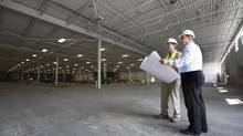 Cameron Ball, left, and Larry Wolynetz are partners who are converting a large warehouse in Kitchener, Ont., into a space suited to multiple tenants. (Peter Power for The Globe and Mail)
