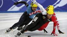 Canada's Olivier Jean races against Simon Cho of the U.S. in the men's 1,500 metres quarterfinal at the World Short Track Speed Skating Championships. (Phil Noble/REUTERS)